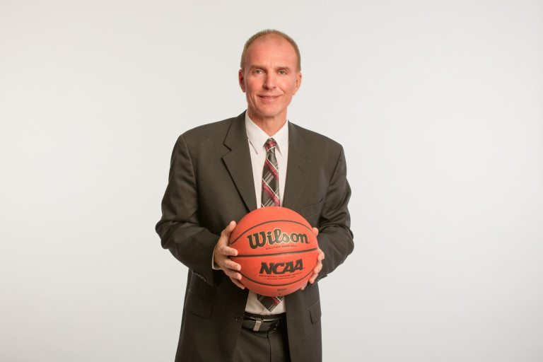 jim-johnson-high-res-suit-with-basketball-768x512